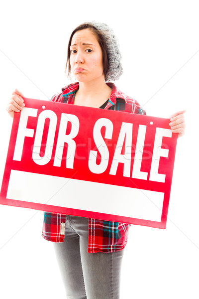 Worried saleswoman showing a for sale sign Stock photo © bmonteny