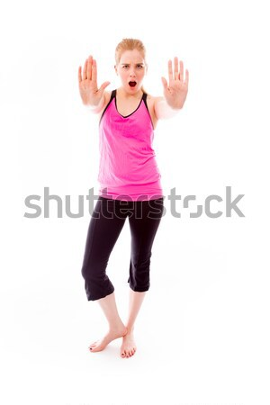 Young woman making stop gesture sign from both hands Stock photo © bmonteny