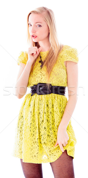 Young woman standing with finger on lips Stock photo © bmonteny
