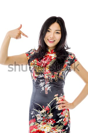 Unhappy Asian young woman giving thumbs down gesture Stock photo © bmonteny