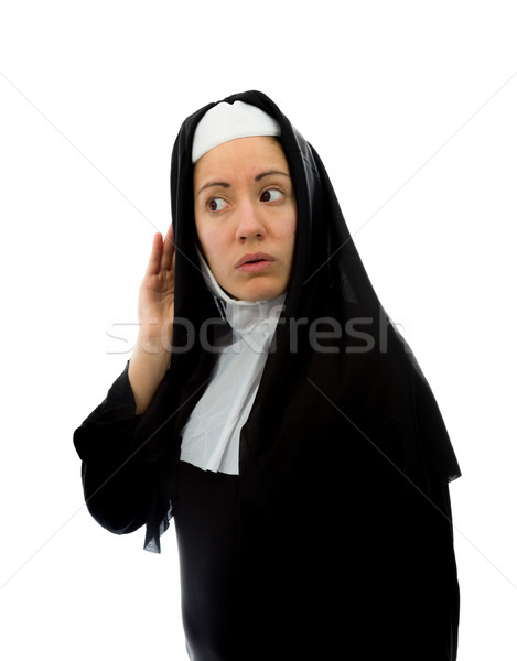Young nun trying to listen Stock photo © bmonteny