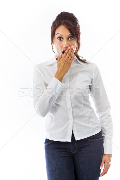 Shocked Indian young woman covering her mouth isolated on white background Stock photo © bmonteny