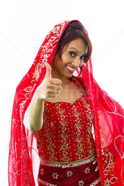 Mosolyog fiatal indiai nő mutat hüvelykujj Stock fotó © bmonteny