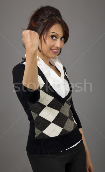 Indian businesswoman punches fist into the air isolated on colored background Stock photo © bmonteny
