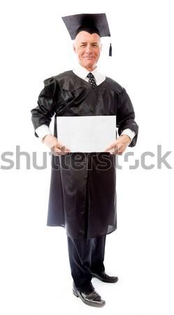 Senior male graduate holding a blank placard Stock photo © bmonteny