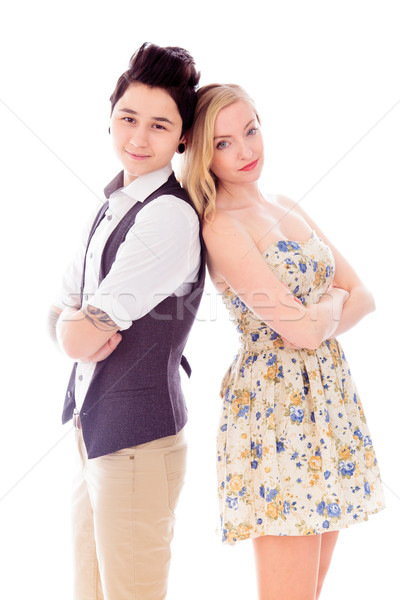 Lesbian couple standing with back to back with their arms crosse Stock photo © bmonteny