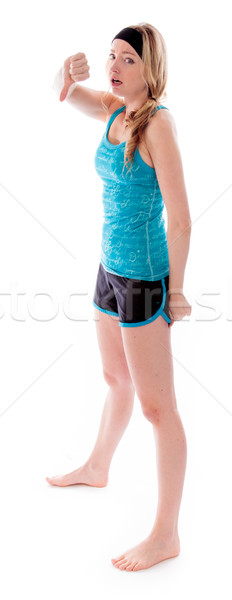 Young woman showing thumbs down sign Stock photo © bmonteny