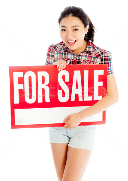 Isolated on white sexy asian cowgirl holding for sale sign Stock photo © bmonteny