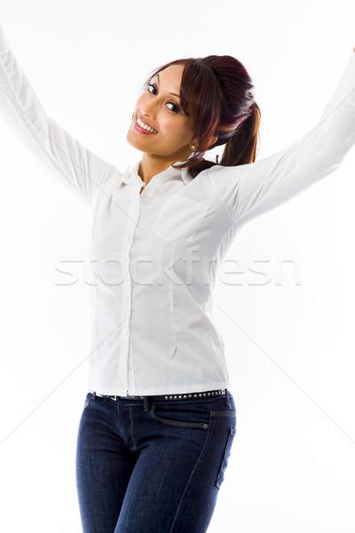 Indian jonge vrouw vieren succes geïsoleerd witte Stockfoto © bmonteny