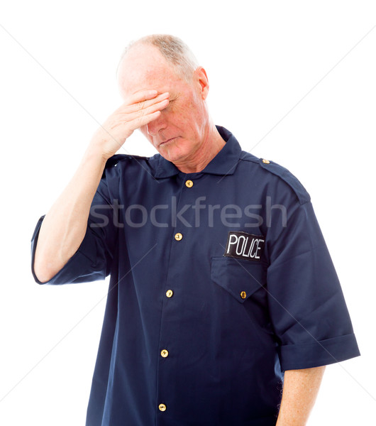 Stock photo: Policeman suffering from headache