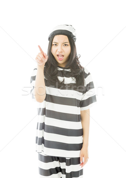 Upset young Asian woman scolding somebody in prisoners uniform Stock photo © bmonteny