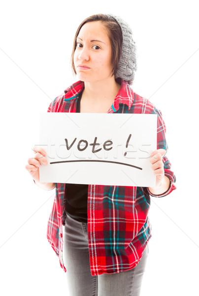 Fiatal nő mutat szavazás felirat fehér fiatal felnőtt Stock fotó © bmonteny