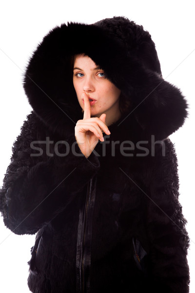Young woman with finger on lips Stock photo © bmonteny