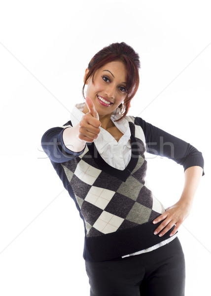 Indian businesswoman making thumbs up sign standing with hand on hip Stock photo © bmonteny