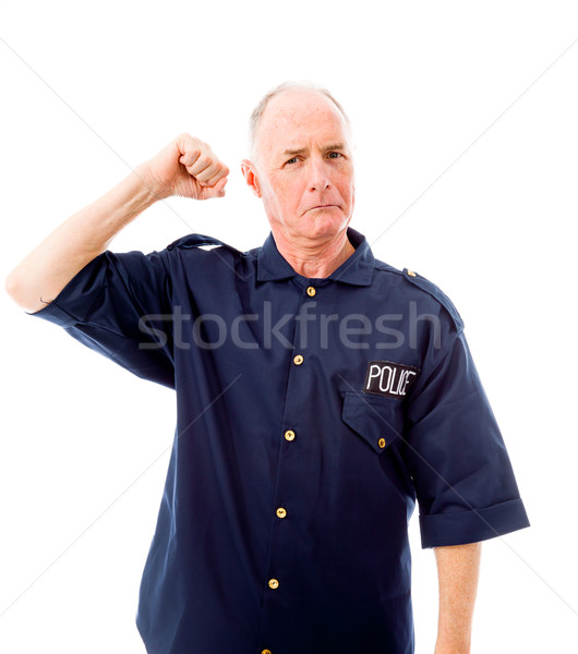 Policeman showing off his muscle Stock photo © bmonteny