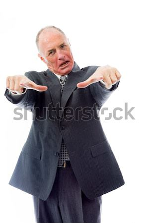 Businessman day dreaming with hand on chin Stock photo © bmonteny