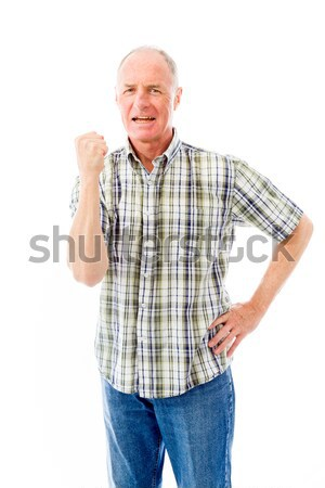 Senior man punching the air Stock photo © bmonteny
