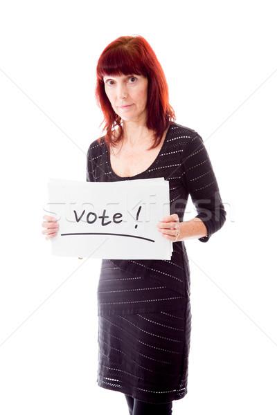 érett nő mutat szavazás felirat fehér portré Stock fotó © bmonteny