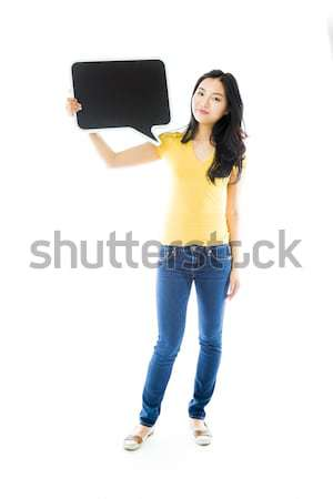 Upset Asian young woman holding a blank speech bubble Stock photo © bmonteny