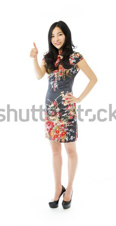 Asian young woman making thumbs up sign standing with hand on hip Stock photo © bmonteny