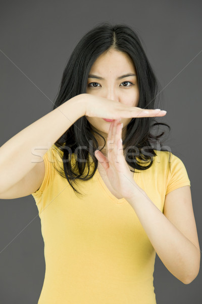 Young Asian woman making time out signal with hands Stock photo © bmonteny