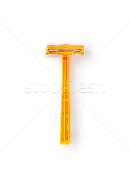 Oranje beschikbaar scheermes geïsoleerd witte Stockfoto © bmonteny