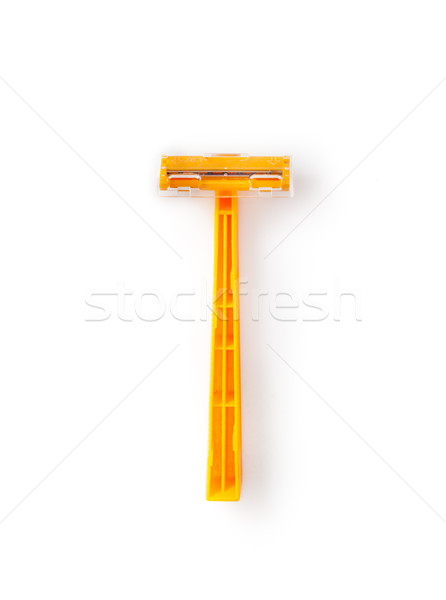 orange disposable razor isolated on a white background Stock photo © bmonteny