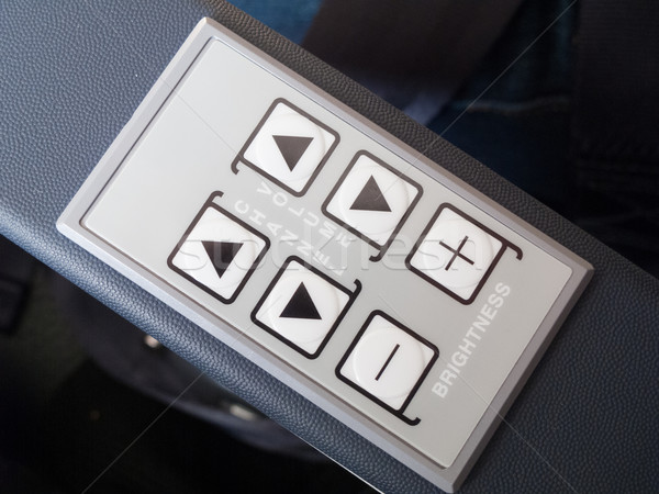 Push buttons on the armrest of airplane seat Stock photo © bmonteny