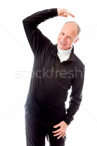 Idős férfi nyújtás mosolyog idős férfi áll Stock fotó © bmonteny