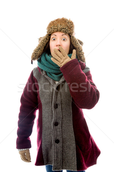 Young woman in warm clothing and looking shocked Stock photo © bmonteny