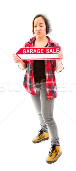 Saleswoman holding a Garage sale sign Stock photo © bmonteny