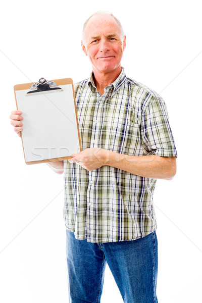 Idős férfi mutat vágólap férfiak portré Stock fotó © bmonteny