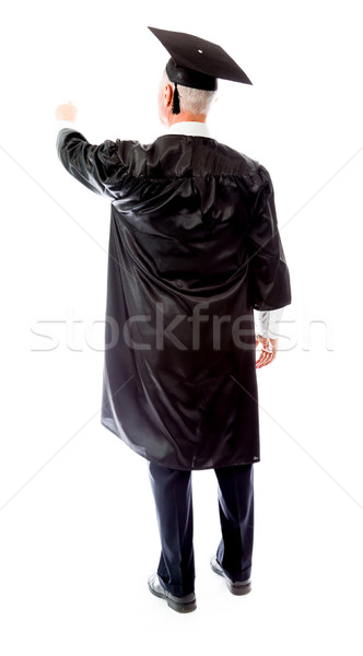 Rear view of a senior male graduate pretending to work on virtua Stock photo © bmonteny