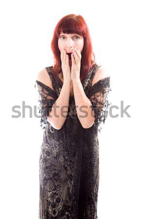 érett nő befogja száját kéz fekete ruha áll Stock fotó © bmonteny