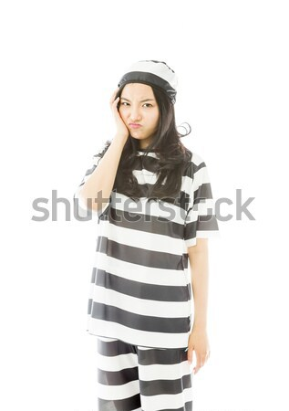 Young Asian woman standing with her arms akimbo in prisoners uniform Stock photo © bmonteny