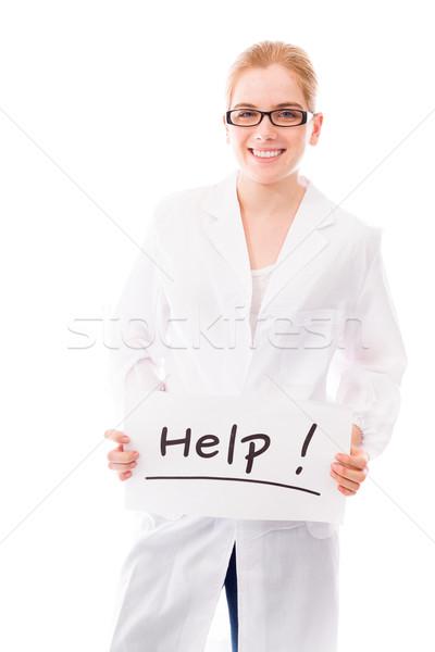 Női tudós mutat segítség felirat fehér Stock fotó © bmonteny