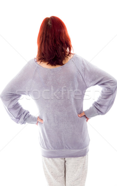 Rear view of a mature woman standing with her arms akimbo Stock photo © bmonteny
