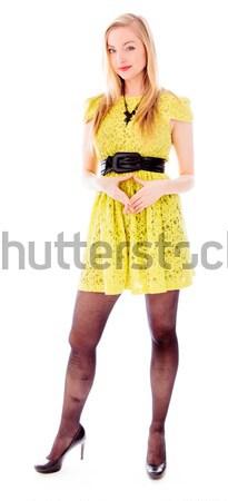 Mulher jovem em pé para baixo assinar Foto stock © bmonteny