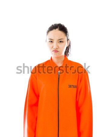 Upset young Asian woman in prisoners uniform Stock photo © bmonteny