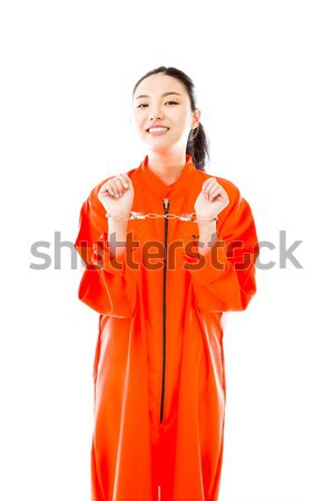 Handcuffed Asian young woman smiling in prisoners uniform Stock photo © bmonteny