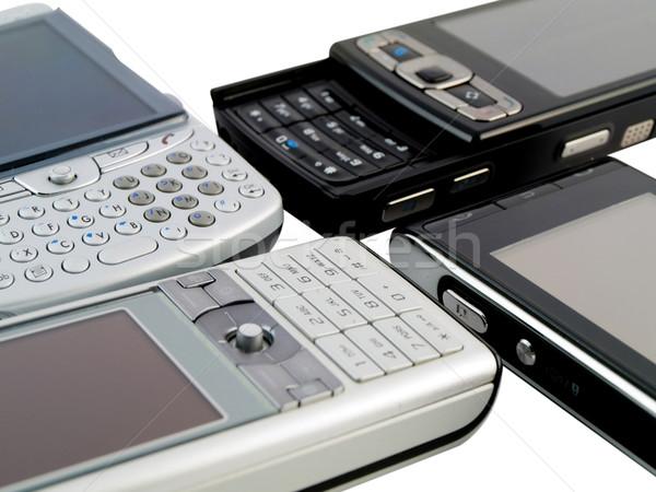 сетке несколько современных Мобильные телефоны белый бизнеса Сток-фото © bobbigmac