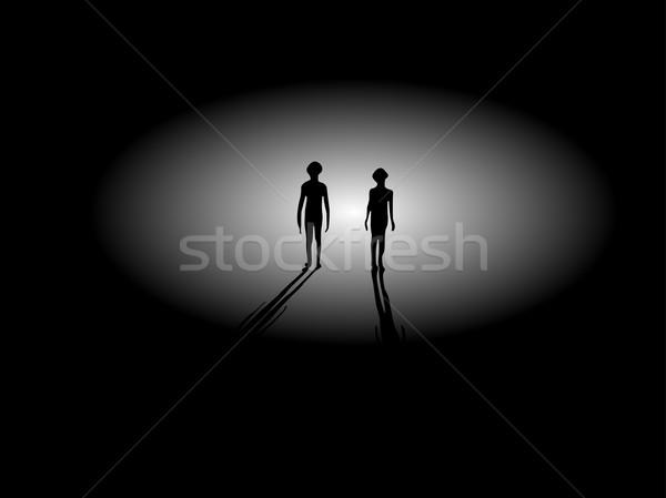 Dois alienígena silhuetas caminhada luz sombras Foto stock © bobbigmac