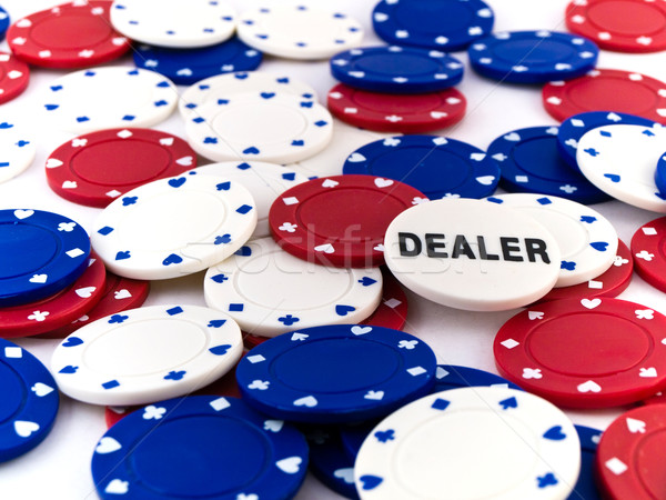 Red White and Blue Poker Chips and Dealer Chip Stock photo © bobbigmac