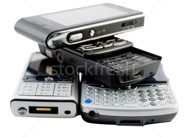 несколько современных Мобильные телефоны белый бизнеса Сток-фото © bobbigmac
