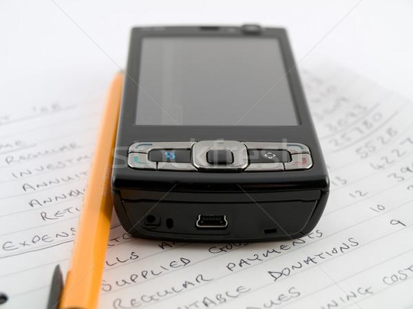 домой бизнеса бюджет мобильного телефона белый Сток-фото © bobbigmac