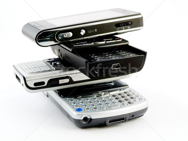 несколько современных Мобильные телефоны КПК Сток-фото © bobbigmac