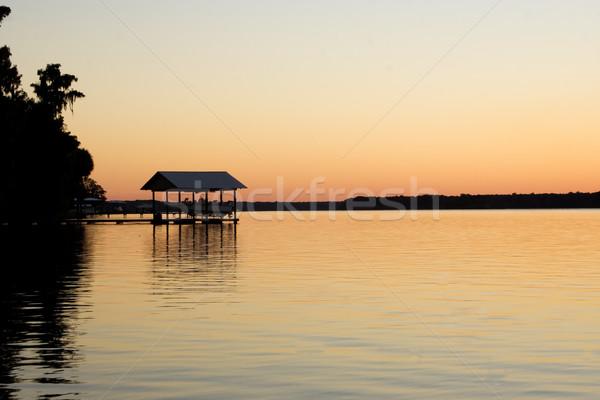 Este folyó csónak kunyhó égbolt naplemente Stock fotó © bobhackett