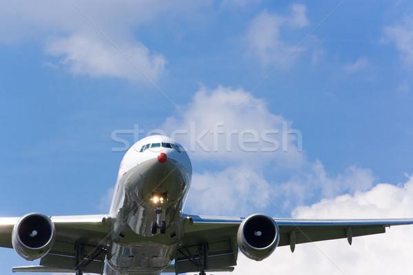 Repülőgép leszállás végső felhők kék repülőgép Stock fotó © bobhackett