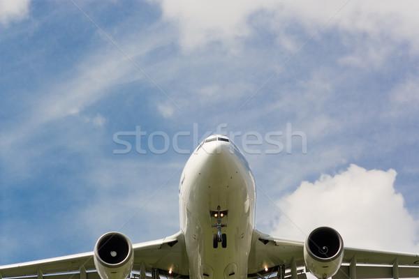 Aterrissagem jato nuvens azul avião férias Foto stock © bobhackett