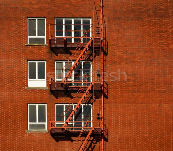 Brand ontsnappen Rood baksteen gebouw drie Stockfoto © bobkeenan